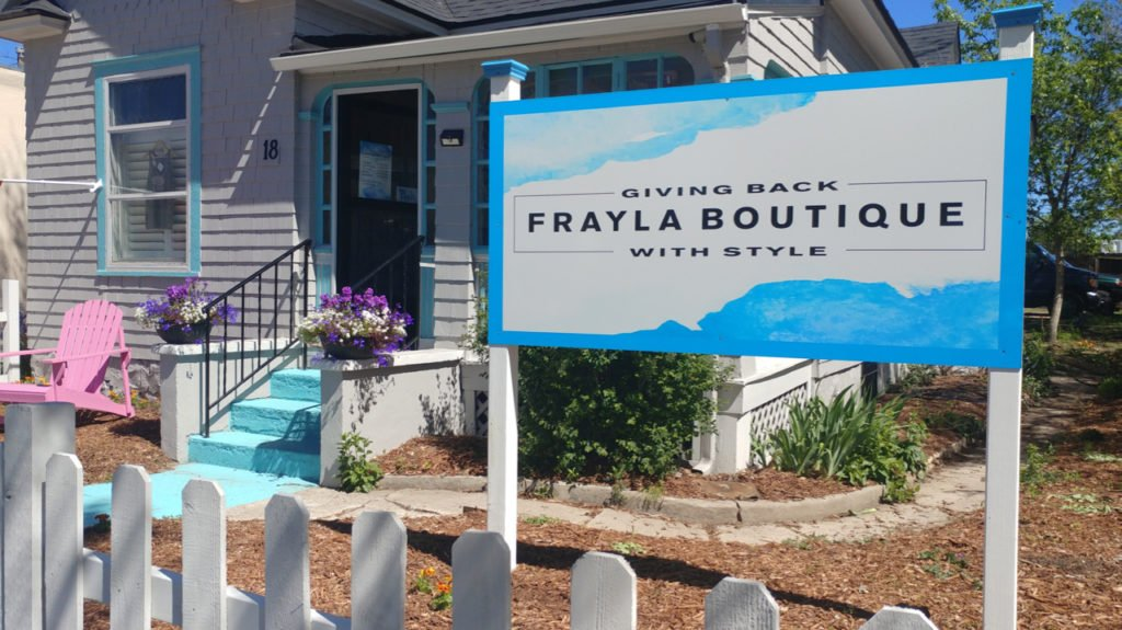 Frayla Boutique Sign, giving back with style