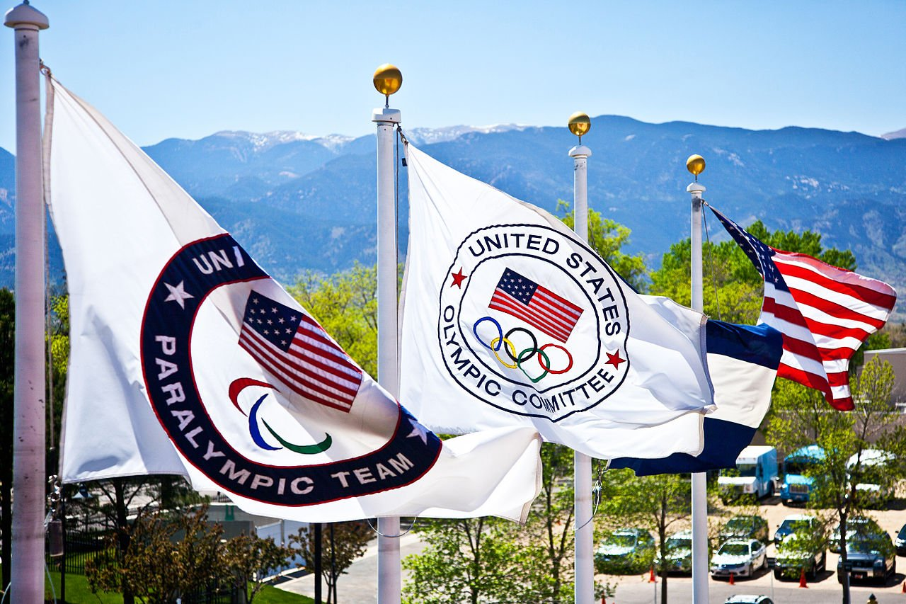 United States Olympic committe flags flying during summertime