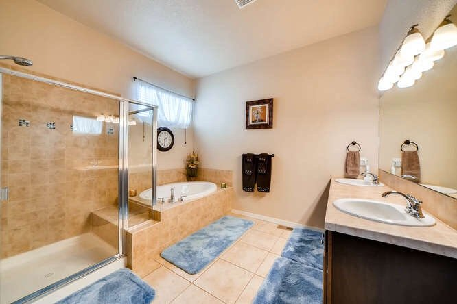 The master bathroom with stand alone shower and tub in 1290 Gold Hill Mesa Drive