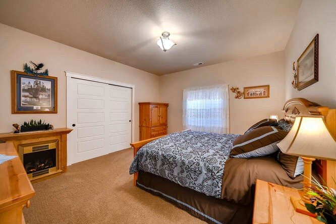 Picture of the master bedroom with a stand alone fireplace in 1290 Gold Hill Mesa Drive
