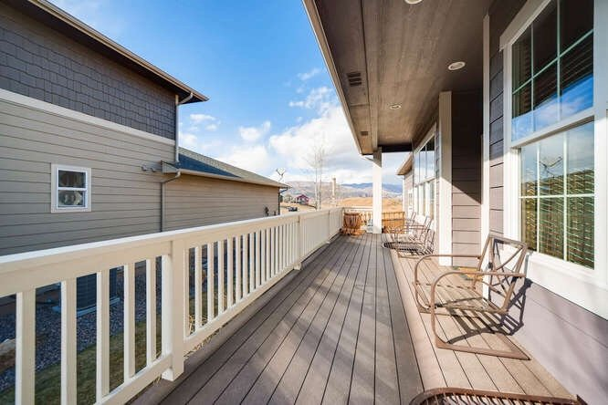 The porch and view from the porch of 1290 Gold Hill Mesa Drive