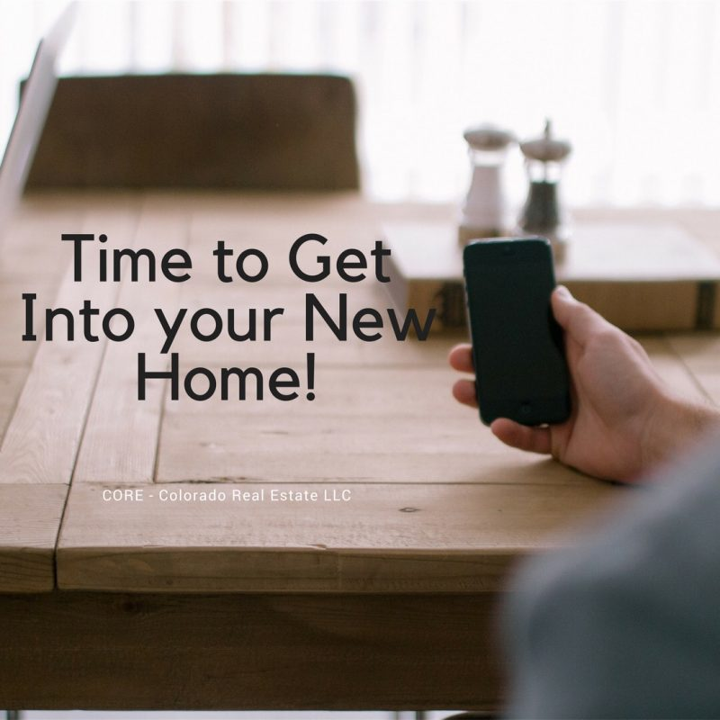 Time to get into your new home, man on cell phone at table